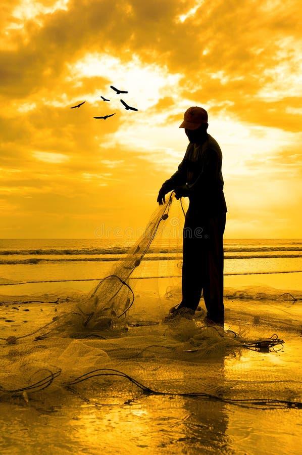 Silhouet van vissers royalty-vrije stock afbeelding