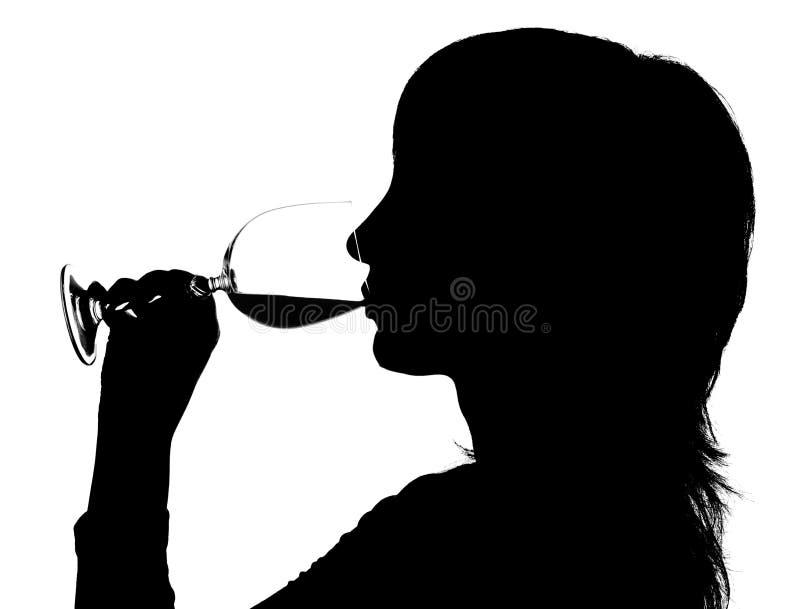 Silhouet van vrouw het drinken royalty-vrije stock foto's