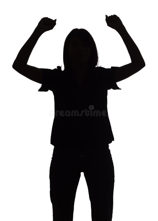 Silhouet van vrouw met omhoog wapens stock fotografie