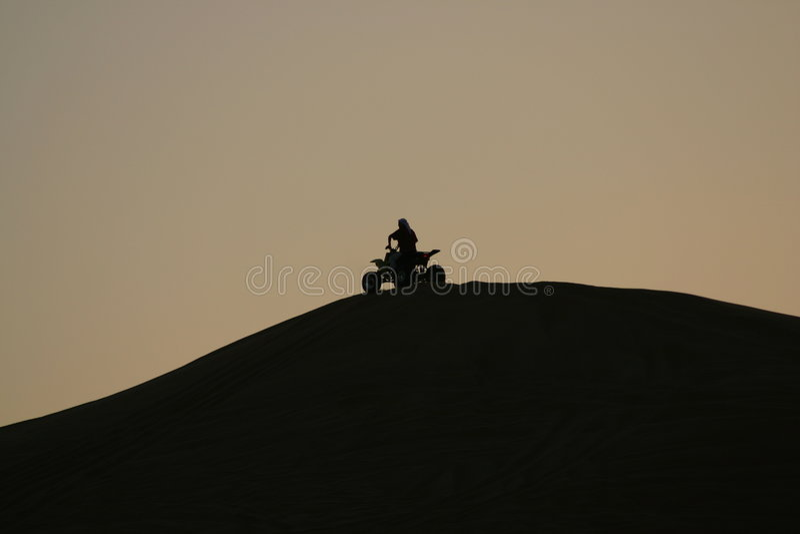 Silhouet - Vierling Biking royalty-vrije stock foto