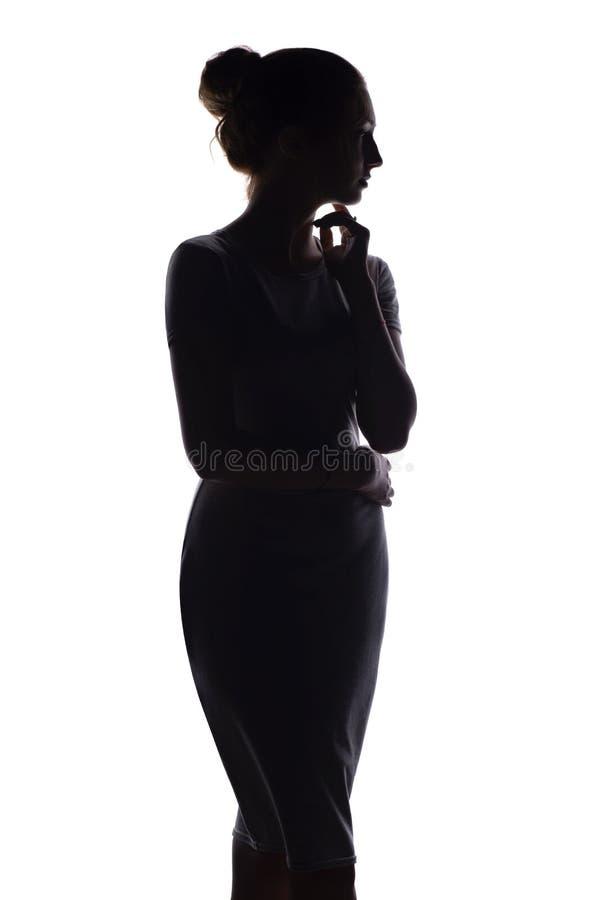 Silhouetprofiel van vrouwencijfer aangaande wit geïsoleerde achtergrond royalty-vrije stock afbeeldingen