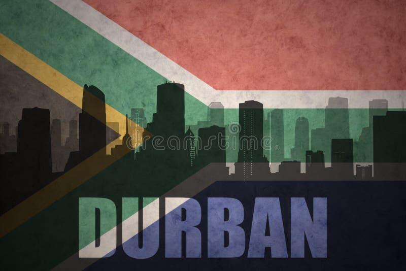 Silhouette abstraite de la ville avec le texte Durban au drapeau de l'Afrique du Sud de vintage photographie stock