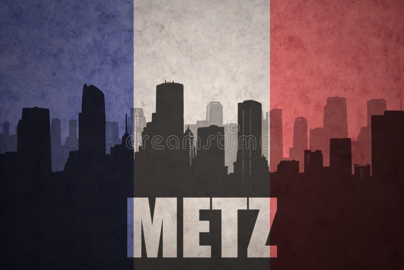 Silhouette abstraite de la ville avec le texte Metz au drapeau de Français de vintage photo libre de droits