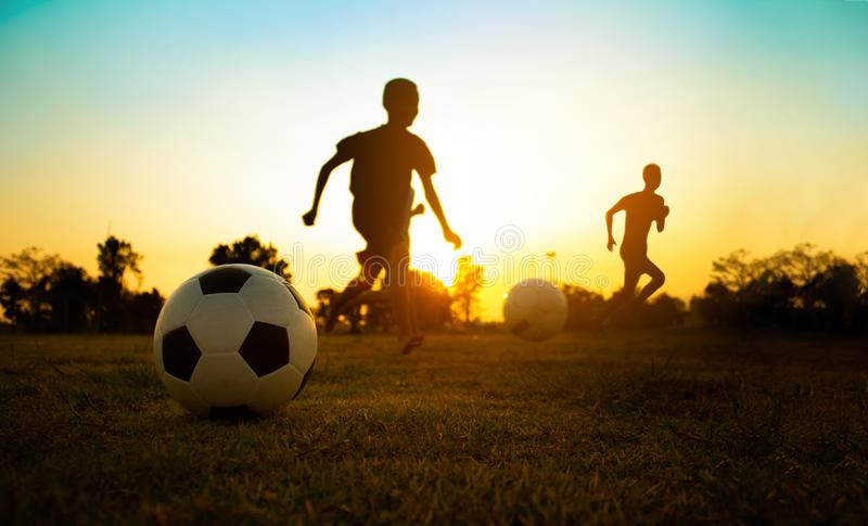 Kids playing soccer football. royalty free stock images