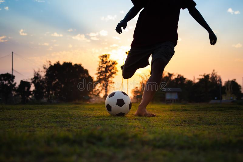 Kids playing soccer football. royalty free stock photography