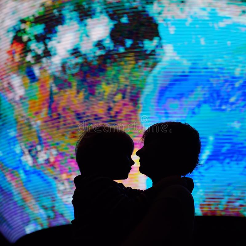 Silhouette of adult and child on background of globe earth. Ecologic and protection environment concept royalty free stock image
