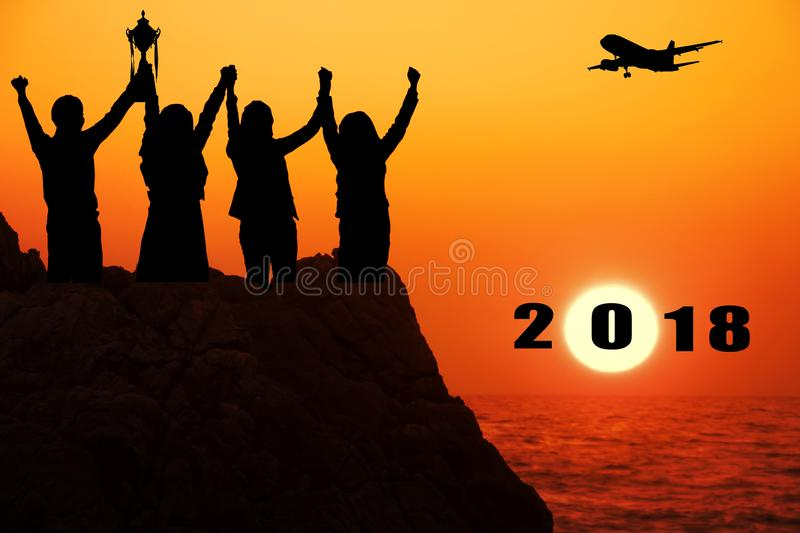 Silhouette airplane with four business people make high hands when business success and trophy receive,2018 new year stock photos