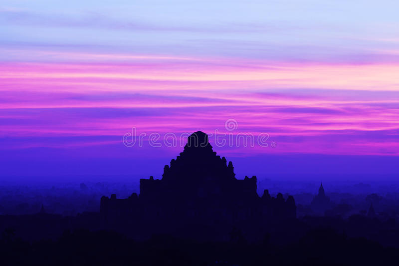 Silhouette of ancient Dhammayangyi Pahto pagoda at sunset in Bag. Silhouette of ancient Dhammayangyi pagoda at sunset in Bagan Archaeological zone, Myanmar stock photography