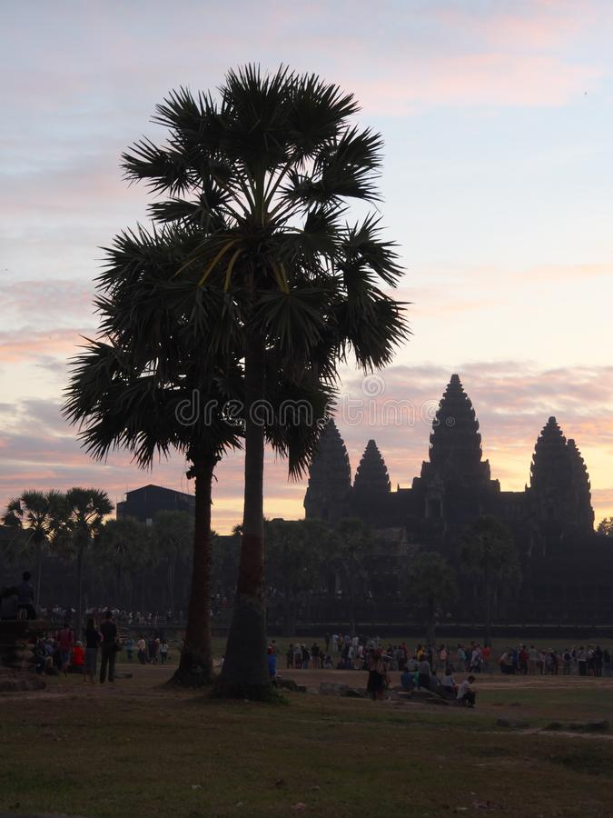 Silhouette of Angkor Wat - famous Cambodian landmark - on sunrise. Siem Reap-December 23, 2017:silhouette of Angkor Wat - famous Cambodian landmark - on sunrise royalty free stock photos