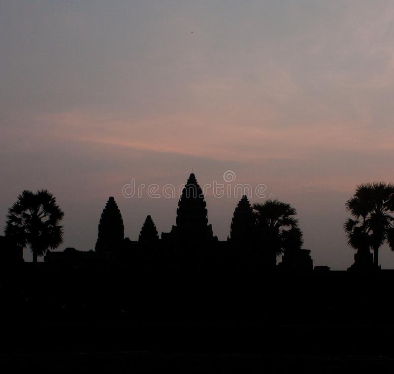 A silhouette of Angkor Wat temple during a sunrise near Siem Reap in Cambodia stock images