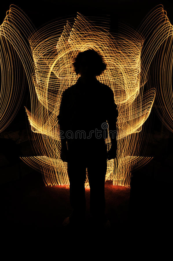 Download Silhouette Of Anonymous Man Standing Stock Photo - Image: 12911740