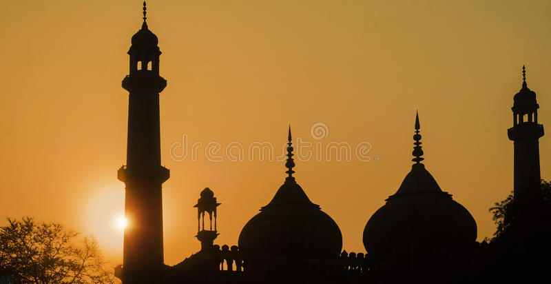 Silhouette - Asafi Masjid. Asafi Masjid (mosque) was built in 1784 by Asaf-ud-Daula as a famine relief project in Lucknow, Uttar Pradesh, India stock photo