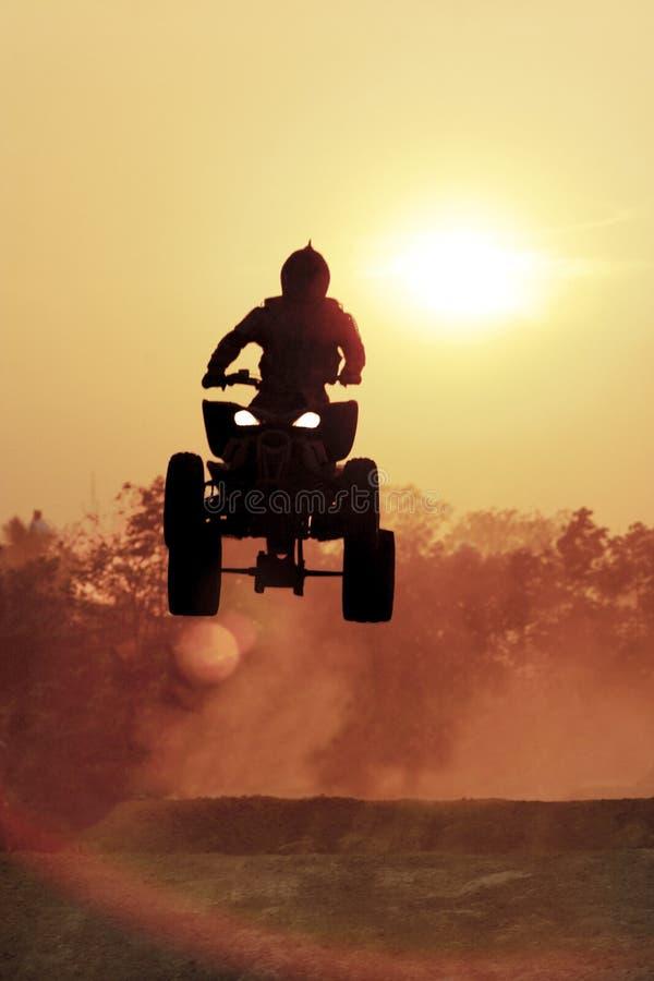 Silhouette ATV jump stock image