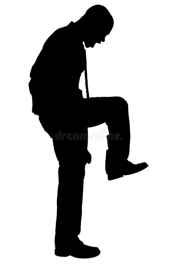 Silhouette avec le chemin de découpage de l'homme fâché frappant du pied illustration libre de droits