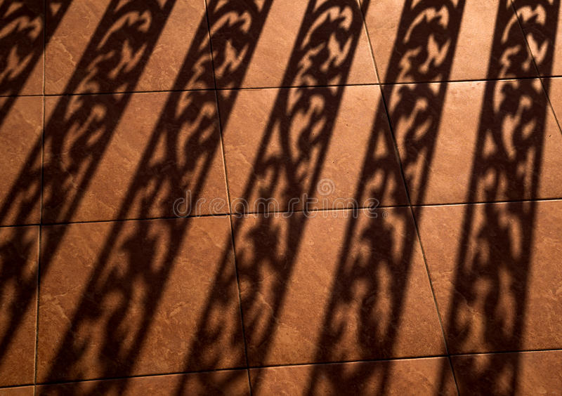 Silhouette background of baluster, Architectural element, worm light shadow on the ground.  stock photo