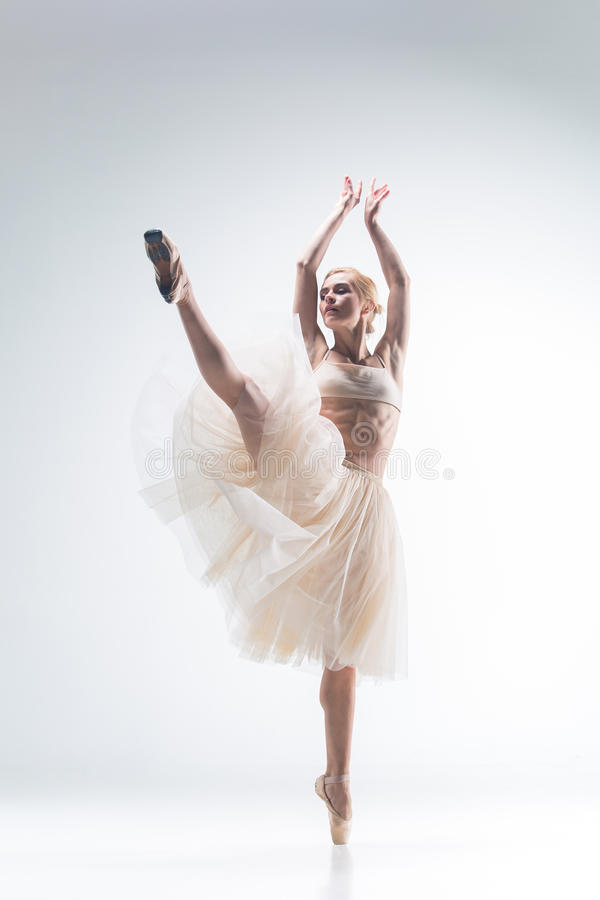 The silhouette of ballerina on white background stock images