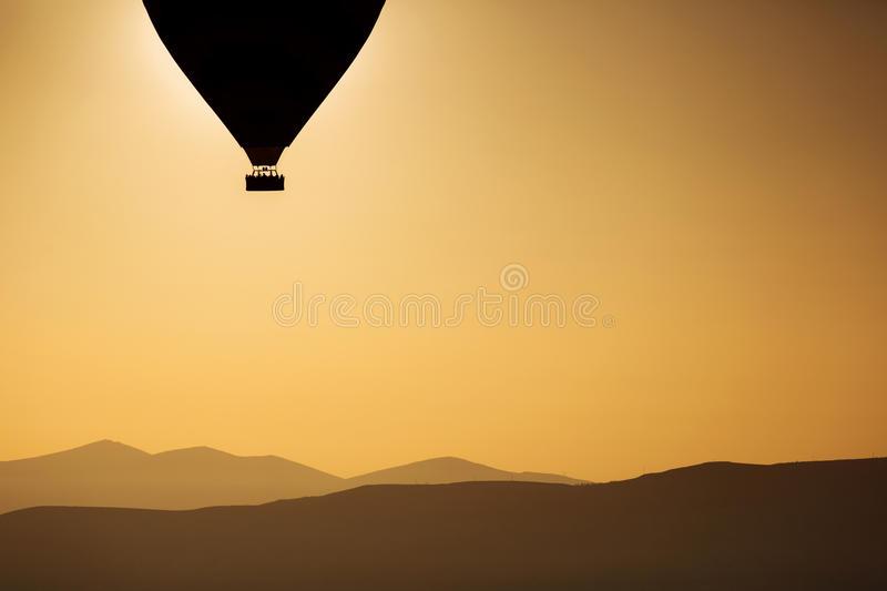 Silhouette of balloons with sunrise in background, aerial view stock images