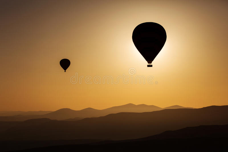 Silhouette of balloons with sunrise in background, aerial view stock photos