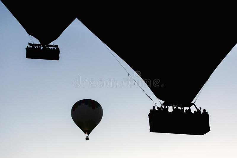 Silhouette of balloons with sunrise in background, aerial view.  royalty free stock photo