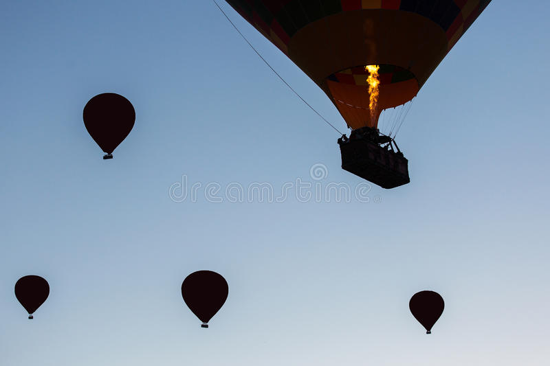 Silhouette of balloons with sunrise in background, aerial view royalty free stock images
