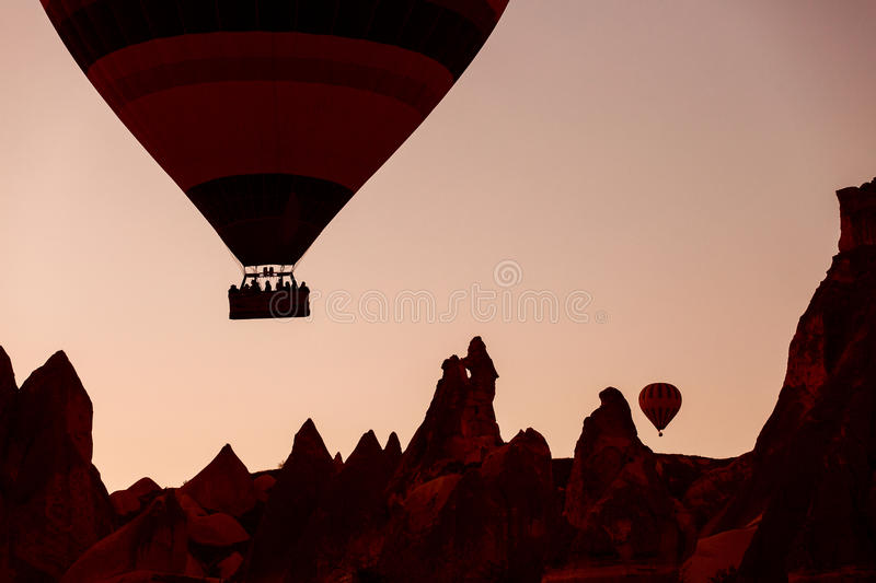 Silhouette of balloons with sunrise in background, aerial view stock photography