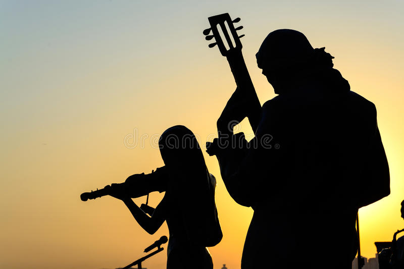 Silhouette of band playing the music. At sunrise royalty free stock photos