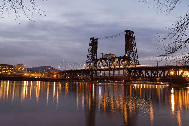 Silhouette bascule bridge across Willamette river in Portland ni. Colorful landscape panorama night Portland office buildings and silhouette with a drawbridge royalty free stock images