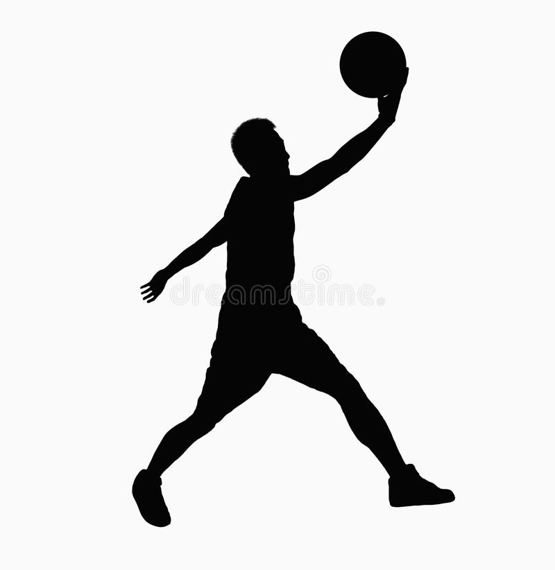 Silhouette of basketball player jumping with ball. stock photography