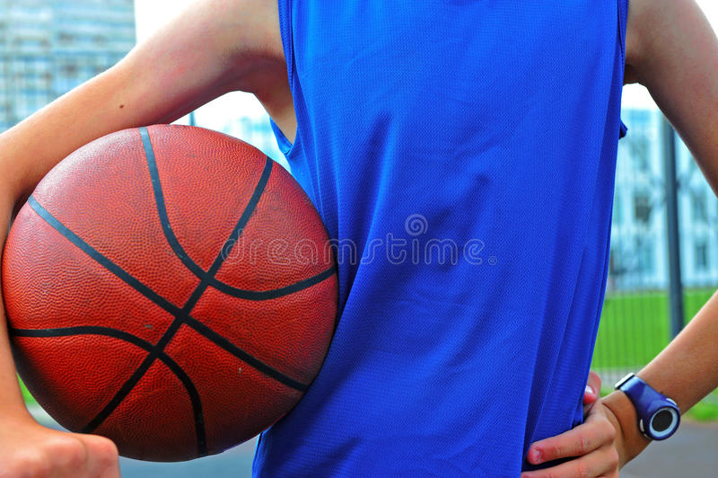 Silhouette of a basketball player outdoor. Silhouette of a basketball player with the ball in his hands, outdoor scene stock photos