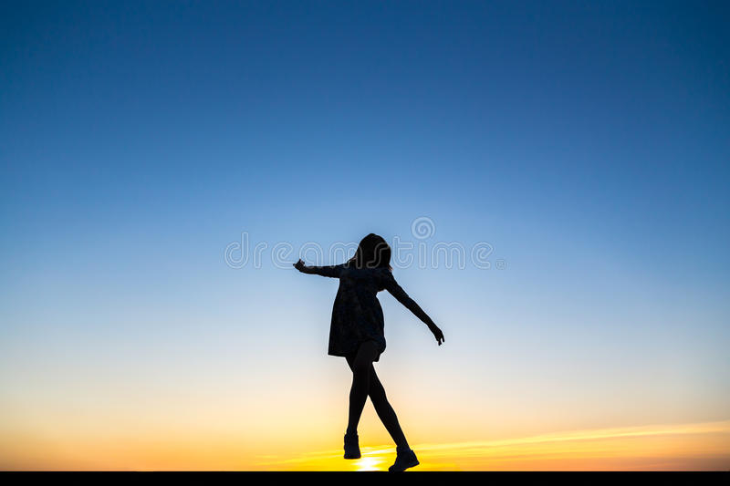 Silhouette of a beautiful happy healthy woman dancer stock image
