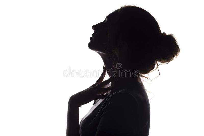 Silhouette of beautiful sensual girl, woman face profilee on white isolated background, concept of beauty and fashion stock image