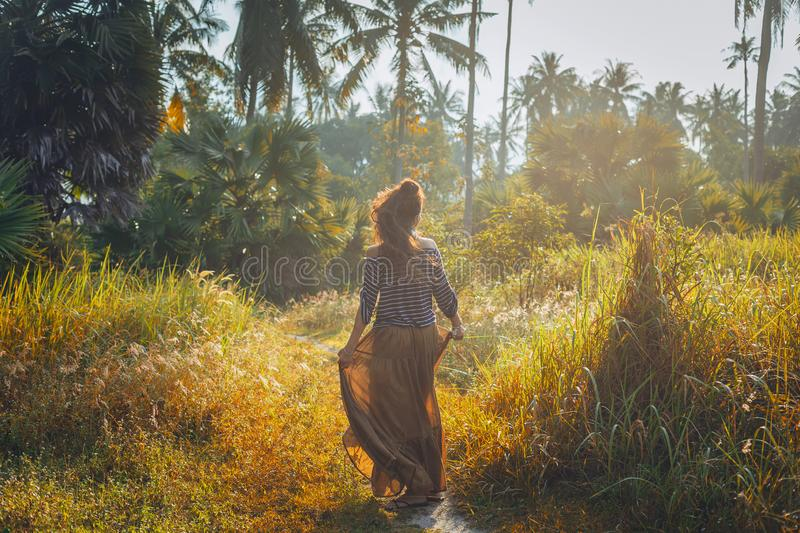 Silhouette of beautiful young boho woman outdoors at sunset stock photos