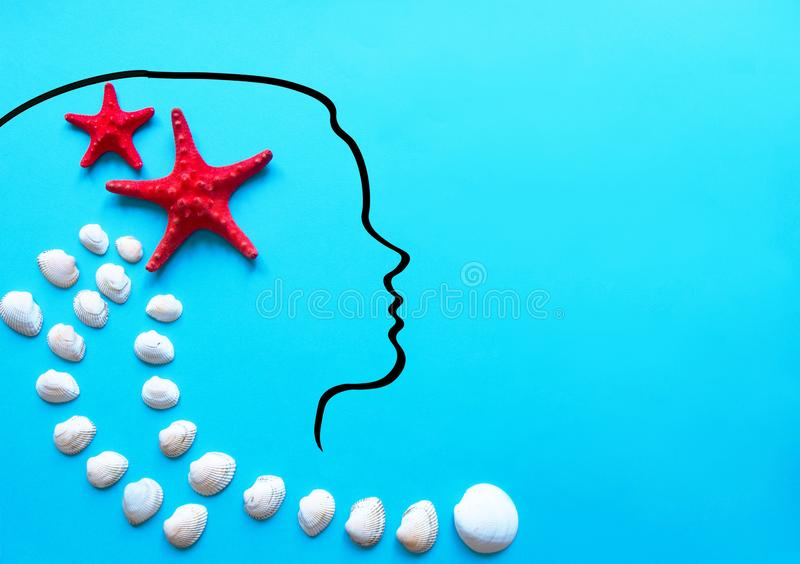 Silhouette of a beautiful young woman two starfish and seashells.Spa,recreation stock image