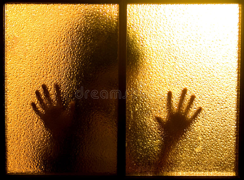 Silhouette behind a glass door royalty free stock photography