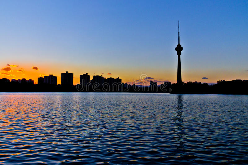 The silhouette of Beijing TV tower. Beijing TV tower at sunset,in Yuyuantan park royalty free stock photography