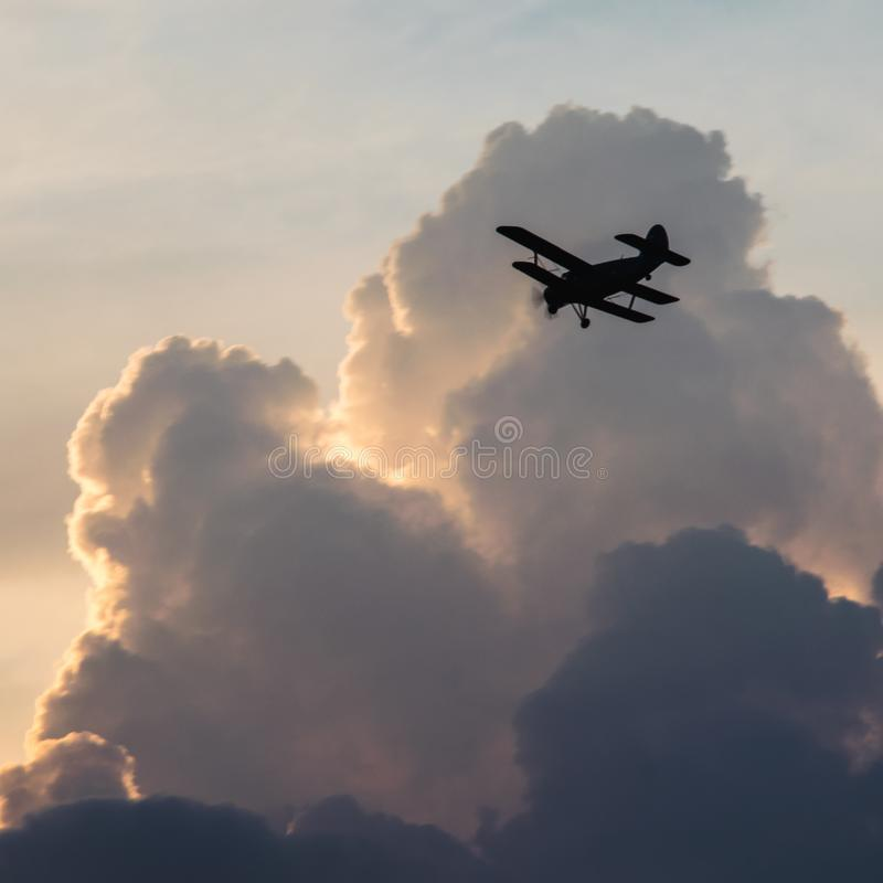 Silhouette of a biplane airplane stock photo