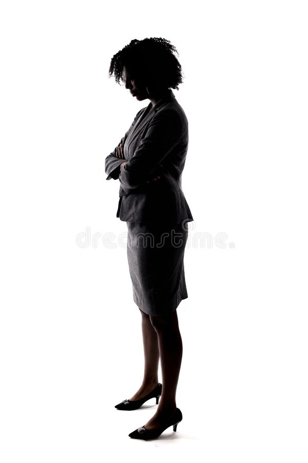 Silhouette of a Black Businesswoman with Sad Gesture royalty free stock image