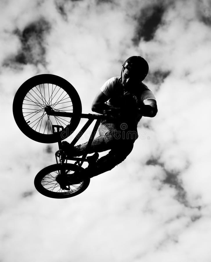 Silhouette of bmx riders in action. Black silhouette of bmx riders in action royalty free stock photography