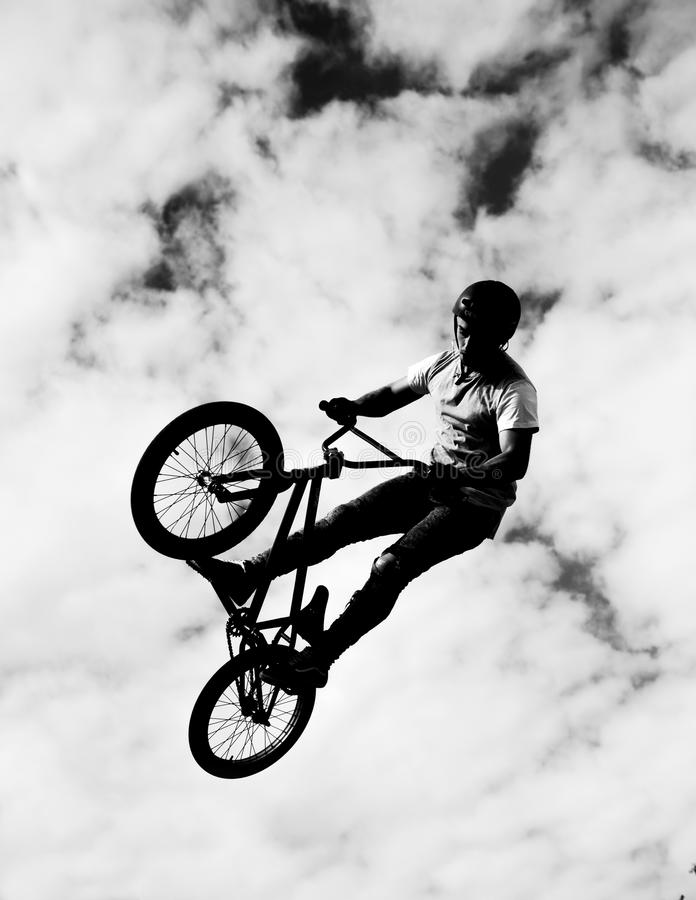 Silhouette of bmx riders in action. Black silhouette of bmx riders in action royalty free stock image