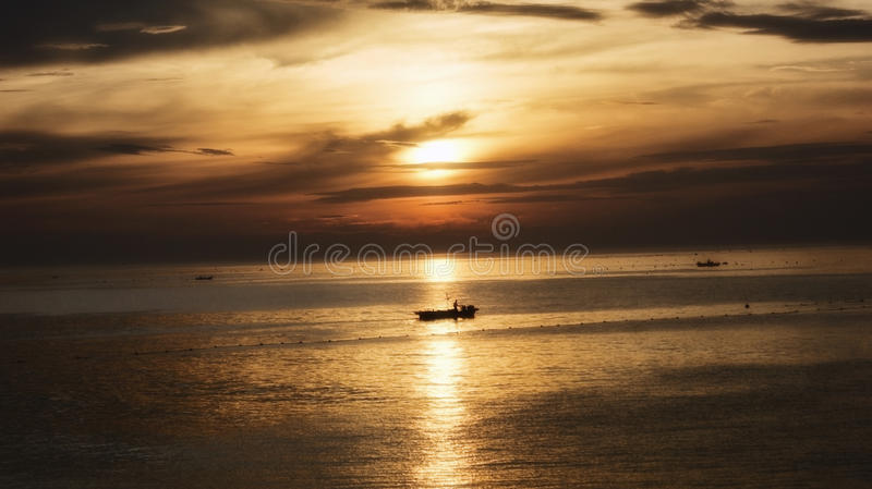 Silhouette Of Boat On Body Of Water Under Cloudy Sky During Sunset Free Public Domain Cc0 Image