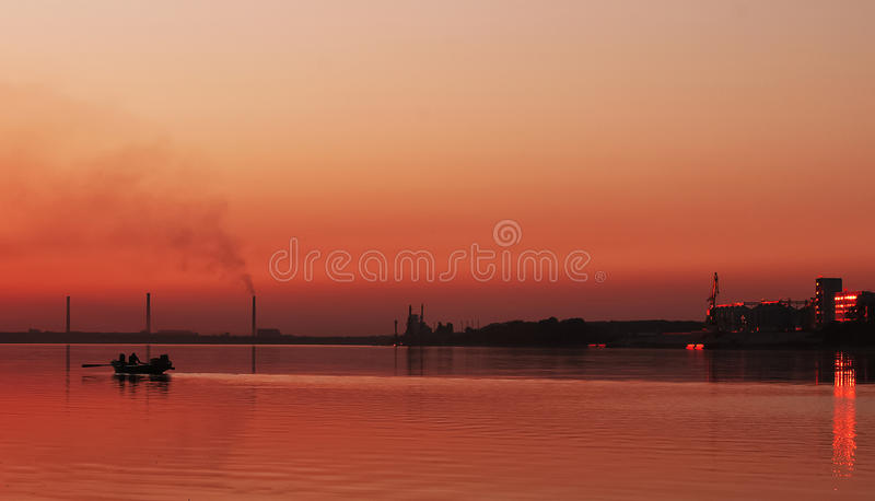 Silhouette of boat in the river on twilight time royalty free stock photo