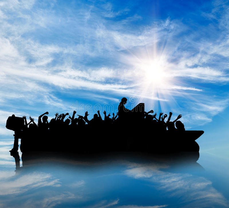 Silhouette of boats with refugees. Concept of refugee. Silhouette of a boat floating in a sea of refugees to the border stock photos
