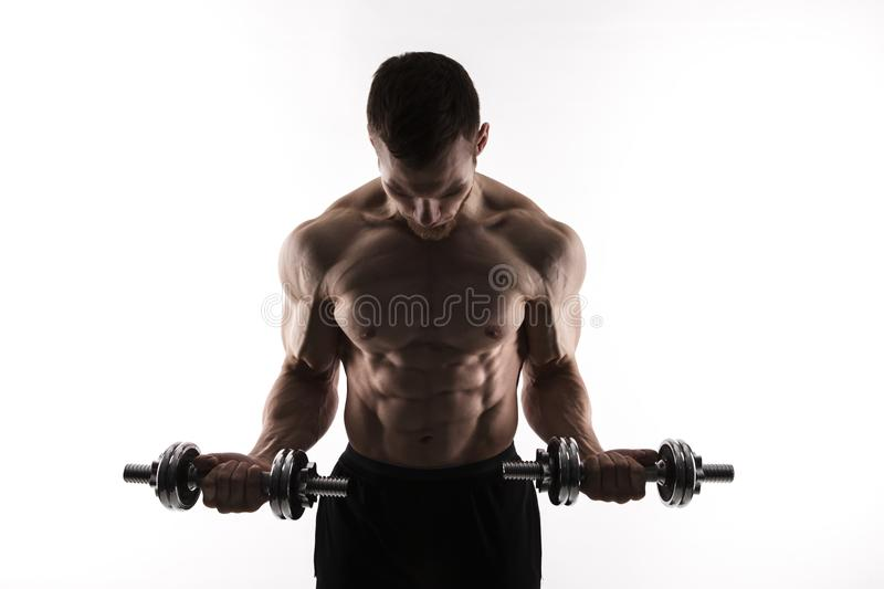 Silhouette of a bodybuilder on a white background royalty free stock photography