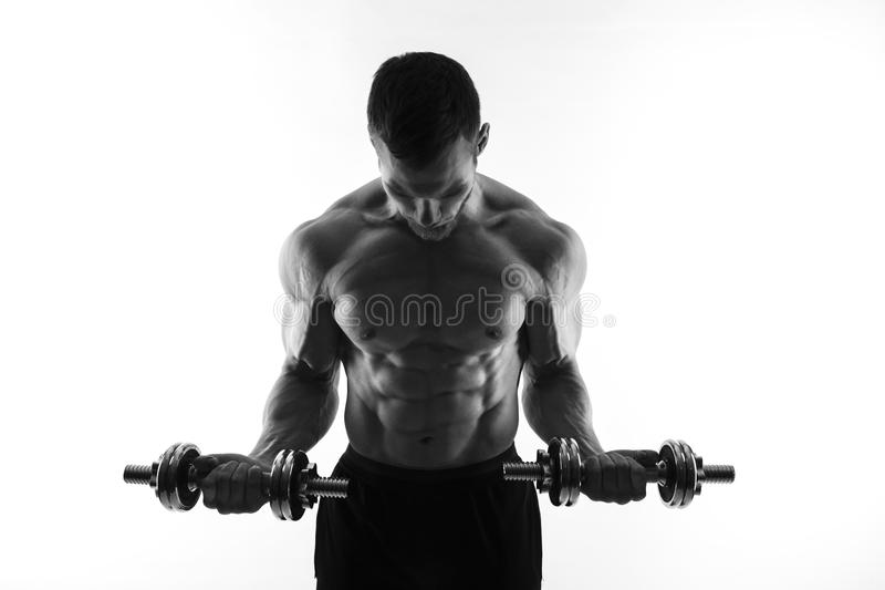Silhouette of a bodybuilder on a white background stock photo