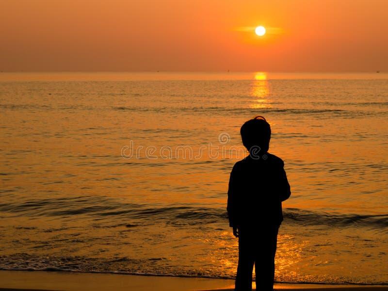 Boy Standing At Beach Free Stock Photo - Public Domain
