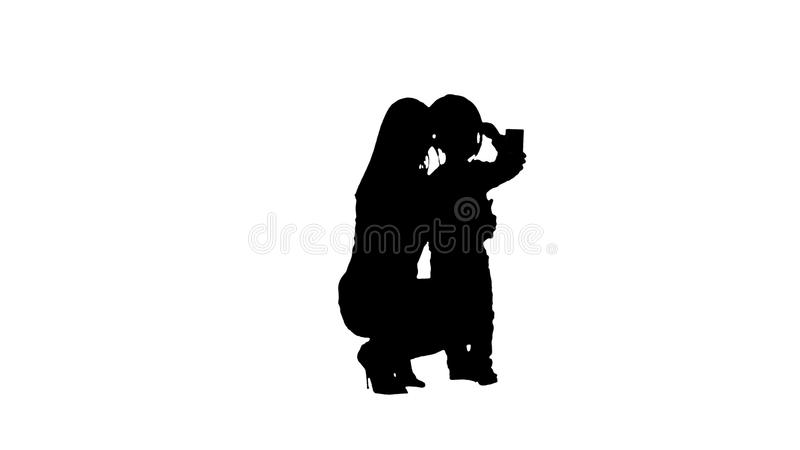 Silhouette Boy taking a selfie with her mother stock illustration