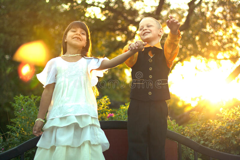 Silhouette of boy and woman jumping royalty free stock image