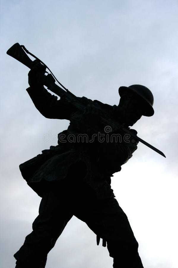 Silhouette of the British Tommy with drawn bayonet on the war memorial in the Diamond Londonderry Northern Ireland. Silhouette of the British Tommy war memorial stock images