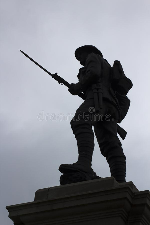 Silhouette of a British Tommy with drawn bayonet on a war memorial in Portstewart in Northern Ireland. These memorials are very common throughout Northern stock photography