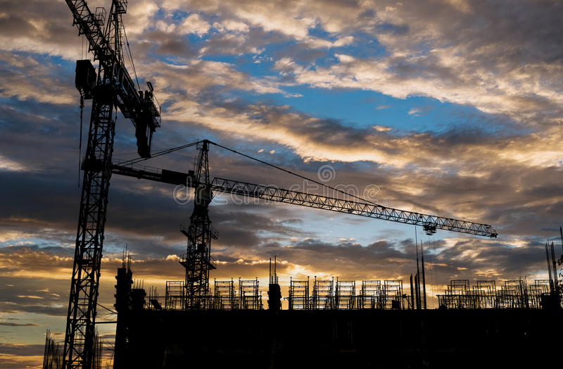 Download Silhouette Building Construction Site With Sunset Sky Background Stock Photo